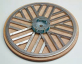 Wooden based grinding disc